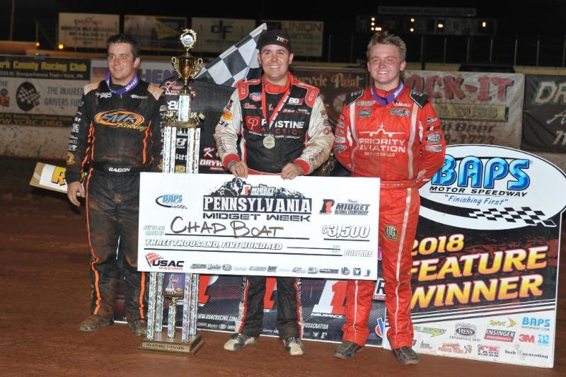 "Chad Boat (middle) stands in BAPS Motor Speedway victory lane following his ""Pennsylvania Midget Week"" win alongside 2nd place finisher Zeb Wise (right) and 3rd place Brady Bacon (left). (Chad Warner Photo)"