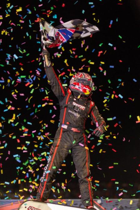 "Cullman, Alabama's Kevin Thomas, Jr. celebrates his fifth career USAC NOS Energy Drink National Midget victory and the first for Petry Motorsports following Saturday night's ""Kokomo Grand Prix"" at Kokomo Speedway. (Adam Mollenkopf Photo)"