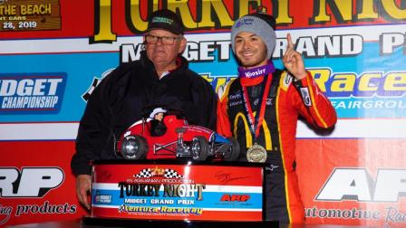 Kyle Larson (right) poses with Ventura Raceway promoter Jim Naylor following Friday night's Turkey Night Grand Prix victory (Rich Forman Photo) (Video Highlights from FloRacing.com)