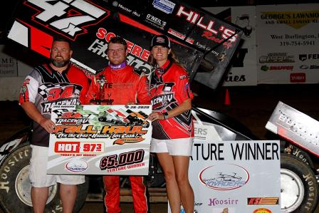 "Dylan Westbrook celebrates his ""Fall Haul"" of $5,000 at 34 Raceway Saturday (MF Photography)"