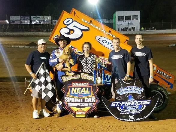 "Brad and the team posed with ""Champ"" for his first photo in Victory Lane Saturday (MOWA Photo)"